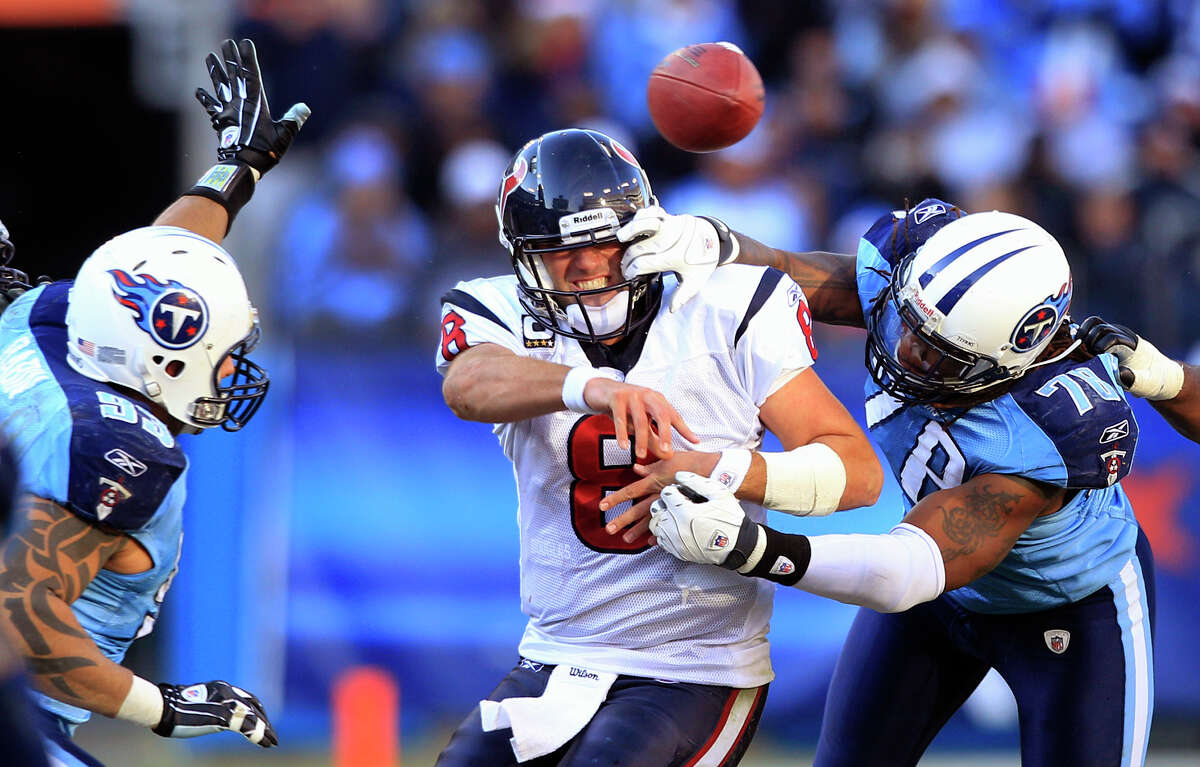 Texans quarterback Matt Schaub is hit by Tennessee's Jacob Ford (78) while throwing a fourth-quarter incompletion.