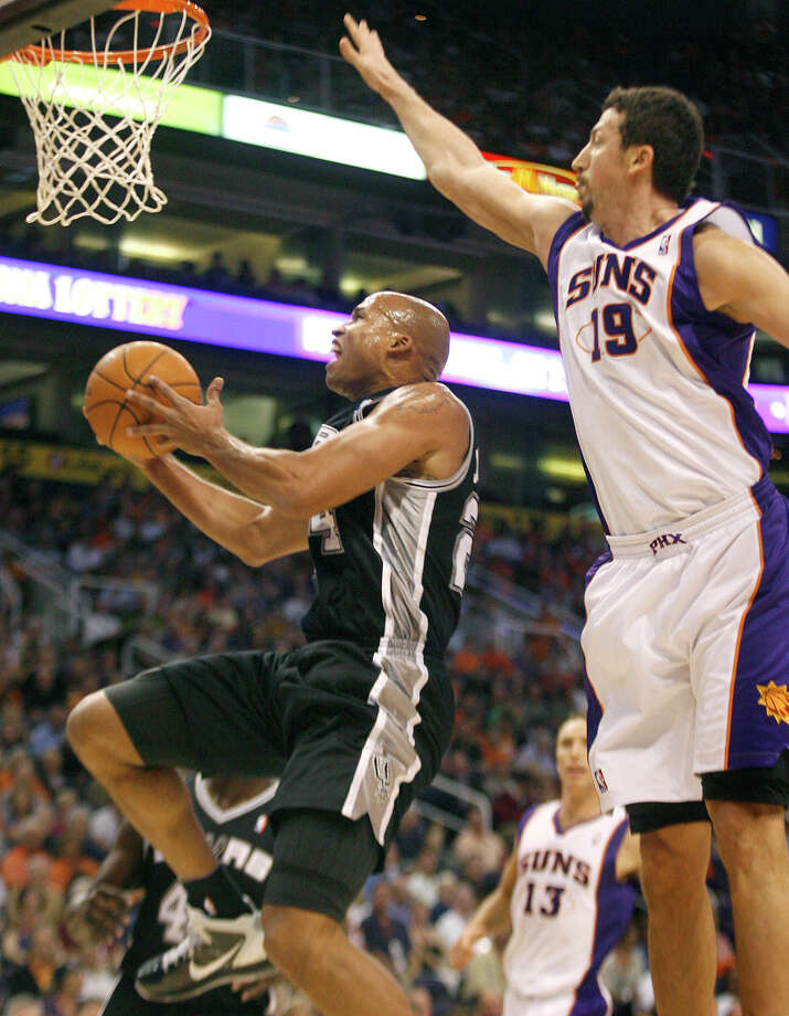 When Richard Jefferson sees former Spur Hedo Turkoglu (right) again, he'll be with the Magic, not the Suns. Photo: Ralph Freso/Associated Press