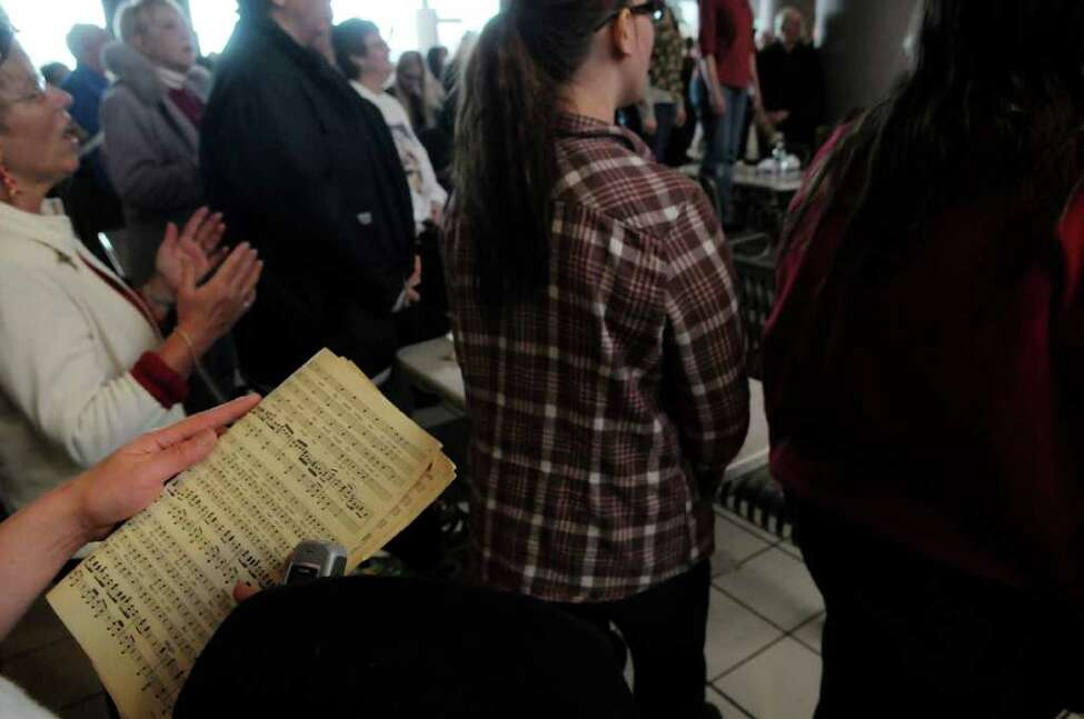 Members of a flash mob, some who brought sheet music, perform the Hallelujah Chorus in the food court at Crossgates Mall in Guilderland on Sunday, Dec. 19, 2010. Over 75 singers from choirs around the region took part in the event. (Paul Buckowski / Times Union)