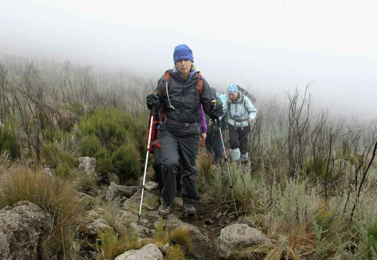 Martina Navratilova treks in the mist on day two of the Martina Navratilova Mt. Kilimanjaro Climb on December 7, 2010 in Arusha, Tanzania. (Photo by Chris Jackson/Getty Images)