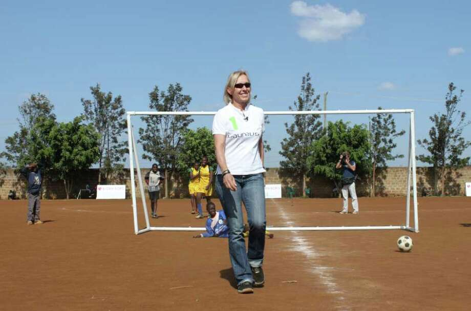 "This Dec. 4, 2010 file photo shows tennis great Martina Navratilova after scoring a goal during a demonstration at a soccer game in Nairobi, Kenya. Navratilova says she ""just couldn't breathe"" while on Africa's highest mountain. She was released from a Nairobi hospital Sunday, Dec. 12, 2010 three days after her fluid-filled lungs forced her to abandon her attempt to climb Mount Kilimanjaro. (AP Photo/Jason Straziuso, file) Photo: Jason Straziuso / AP2010"