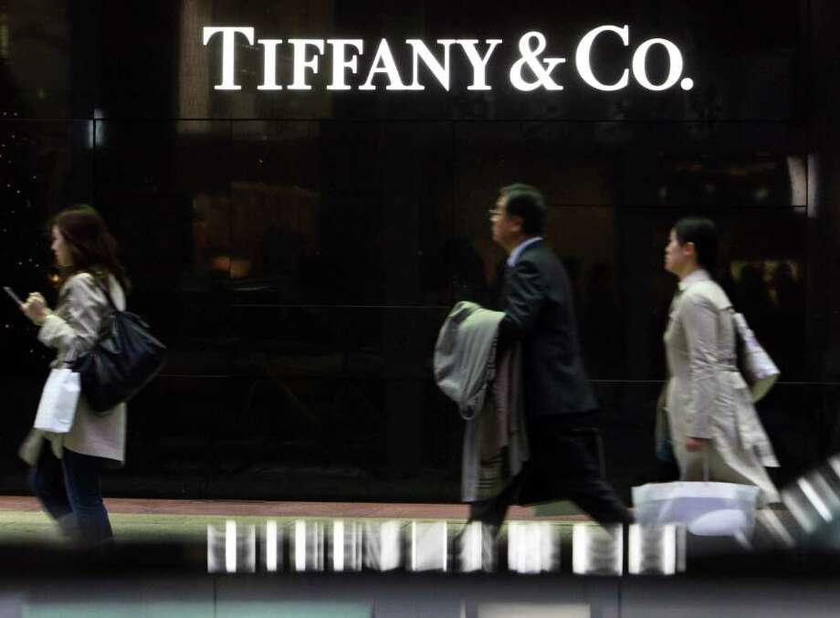 A pedestrian walks past a Tiffany & Co. store in the Ginza district of Tokyo, Japan, on Thursday, Dec. 2, 2010. Prices in Japan as measured by the gross domestic product deflator have been declining almost without interruption since 1994. That's made everything from golfing to hamburgers cheaper, allowing the nation's consumers to afford more even with their shrinking incomes. Photographer: Tomohiro Ohsumi/Bloomberg Photo: Tomohiro Ohsumi, Bloomberg