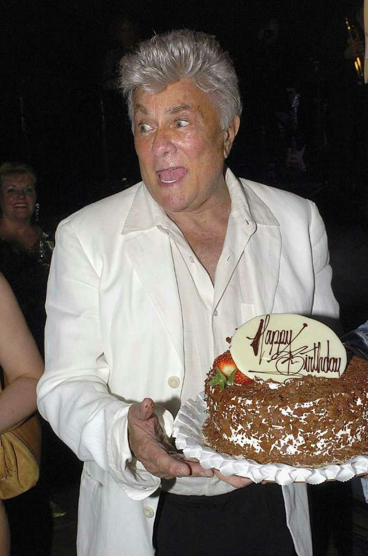 LAS VEGAS, NV - JUNE 15: Actor Tony Curtis holds his birthday cake at the Viva Las Vegas Party during Cinevegas 2005, at the Palms Casino on June 15, 2005 in Las Vegas, Nevada. (Bryan Haraway/Getty Images) *** Local Caption *** Tony Curtis