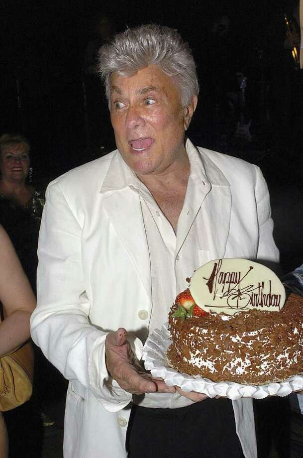 LAS VEGAS, NV - JUNE 15:  Actor Tony Curtis holds his birthday cake at the Viva Las Vegas Party during Cinevegas 2005, at the Palms Casino on June 15, 2005 in Las Vegas, Nevada. (Bryan Haraway/Getty Images) *** Local Caption *** Tony Curtis Photo: Bryan Haraway, Getty Images / Getty Images