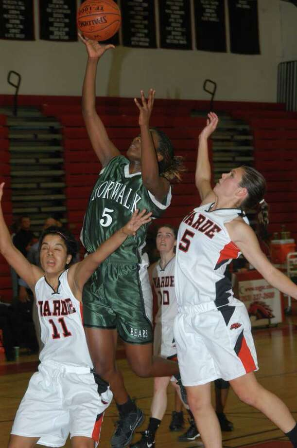 Norwalk forward Rottisha Lewis delivers a shot against Fairfield Warde on Dec. 17. Photo: Andy Hutchison / Norwalk Citizen