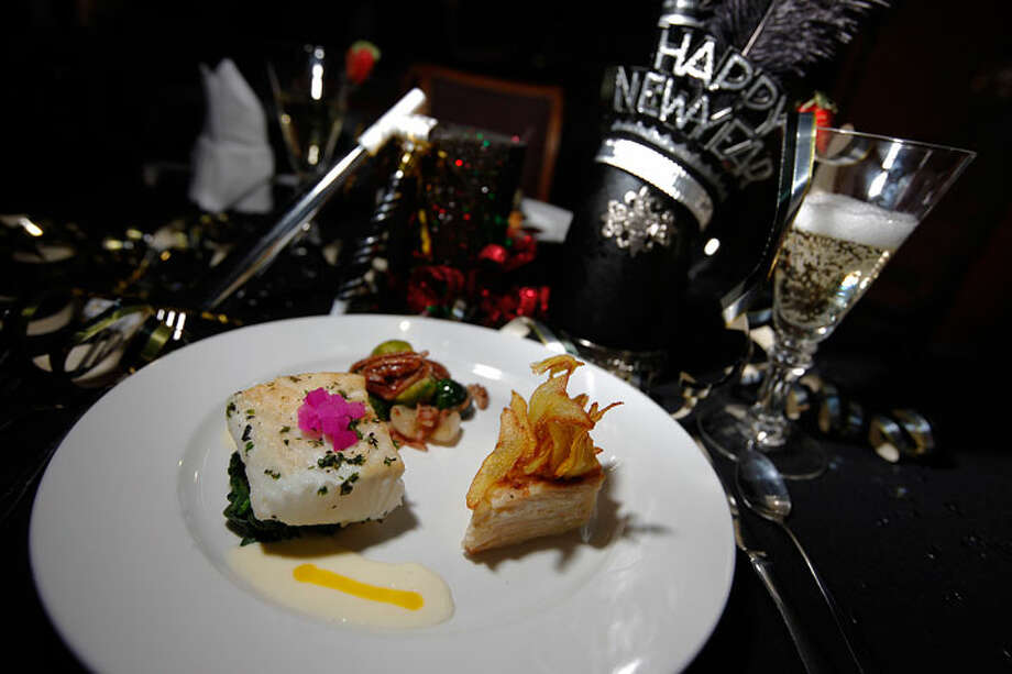 Boardwalk Bistro will hold a New Year's Eve celebration featuring a five-course gourmet menu. Among the dishes will be Chilean Sea Bass in Champagne sauce (pictured) and Peppercorn and Herb encrusted Filet Mignon. Kin Man Hui/kmhui@express-news.net