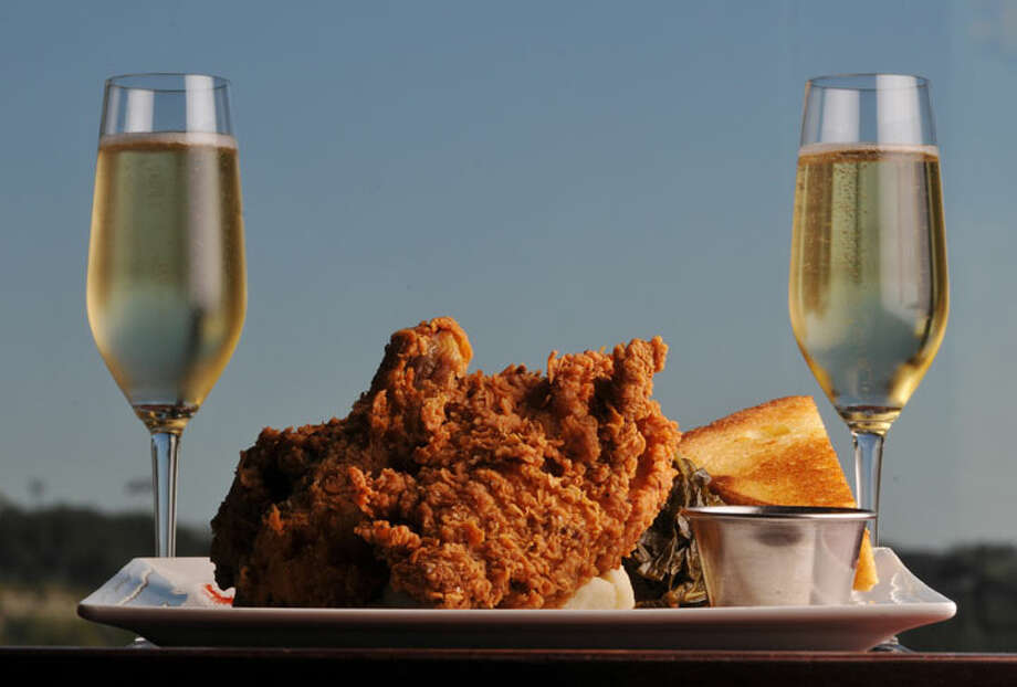 """Max's signature fried chicken is crisp on the outside and moist on the inside. One of the restaurant's slogans is """"Fried chicken and Champagne, why the hell not?""""PHOTO BY ROBIN JERSTAD/SPECIAL TO THE EXPRESS-NEWS"""