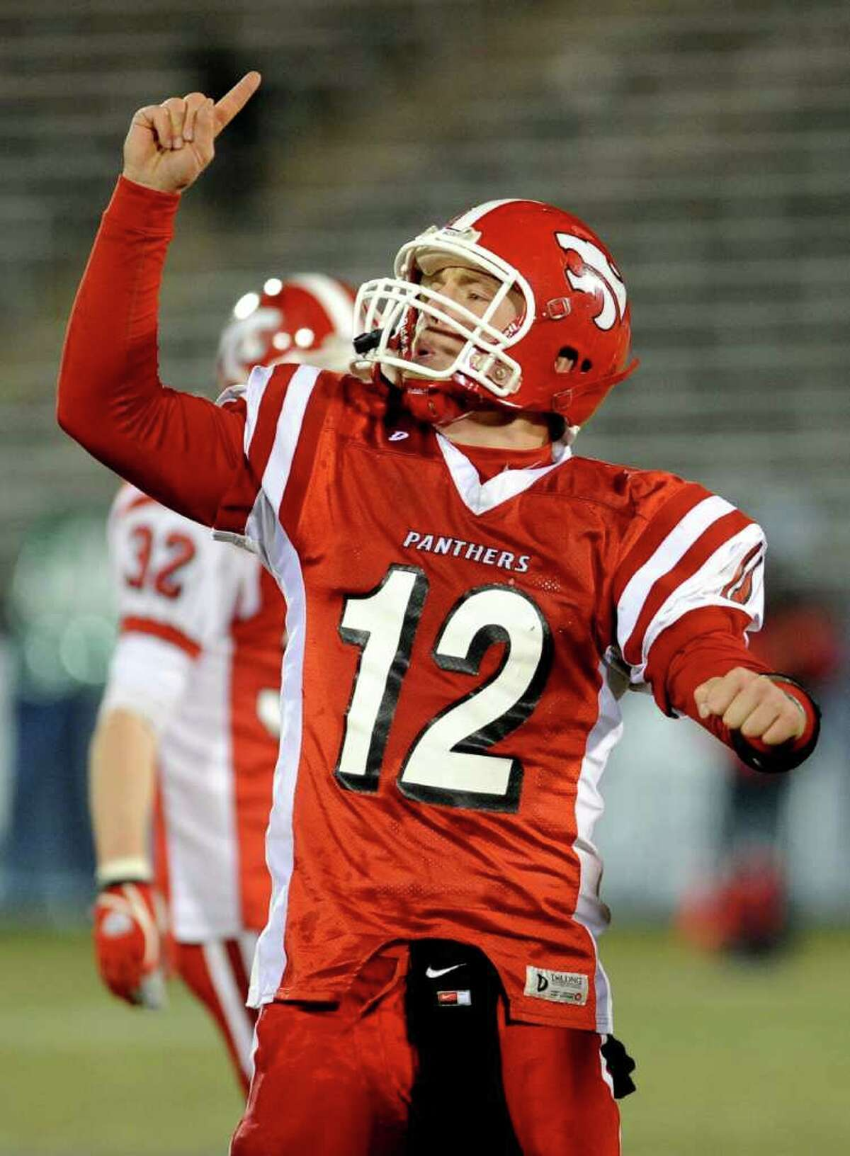 Masuk's Casey Cochran celebrates his team's win at the end of Saturday's Class L football championship game between New Canaan High School and Masuk High School at Rentschler Field in East Hartford on December 11, 2010.