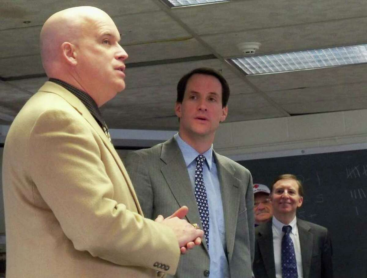 Robert Kenny, left, the Region 1 coordinator for the state Department of Emergency Management Homeland Security, announces the acquisition of 14 emergency shelter trailers Monday at the Fairfield Regional Fire School along with U.S. Rep. Jim Himes, D-Connecticut and First Selectman Kenneth Flatto, right.