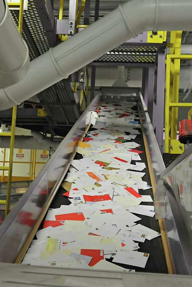 Thousands of Christmas cards sit in bins for processing at the U.S. Post Office main plant on Karner Road in Colonie, NY, on December 20, 2010.  (Lori Van Buren / Times Union) Photo: Lori Van Buren