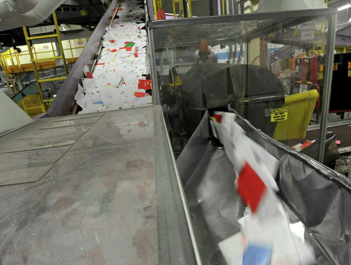 Thousands of Christmas cards sit in bins for processing at the U.S. Post Office main plant on Karner Road in Colonie, NY, on December 20, 2010. (Lori Van Buren / Times Union)