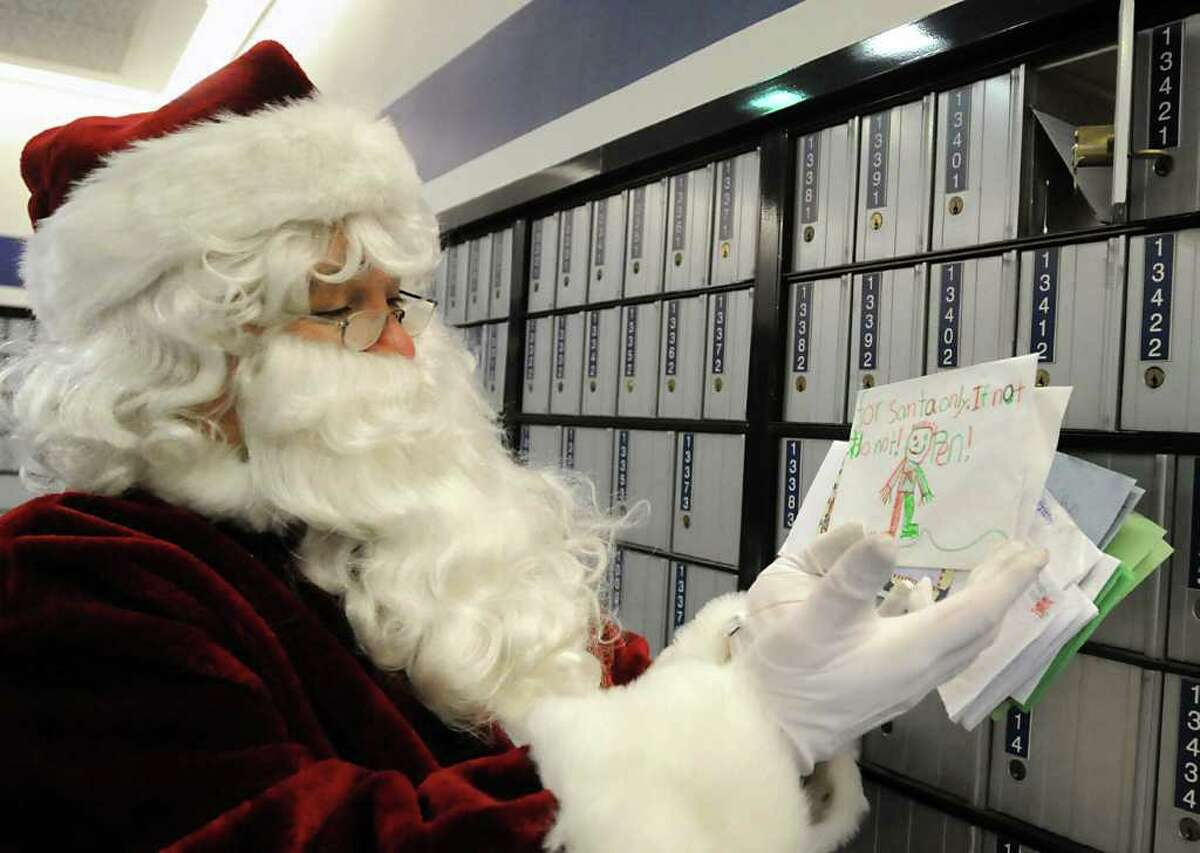 Santa takes letters out of his post office box from children on the busiest mail day of the year at the U.S. Post Office main plant on Karner Road in Colonie, NY, on December 20, 2010. (Lori Van Buren / Times Union)