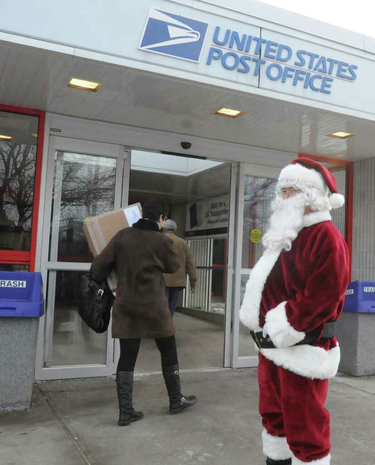 Santa Claus greets customers on the busiest mail day of the year at the U.S. Post Office on Karner Road in Colonie, NY, on December 20, 2010. (Lori Van Buren / Times Union)