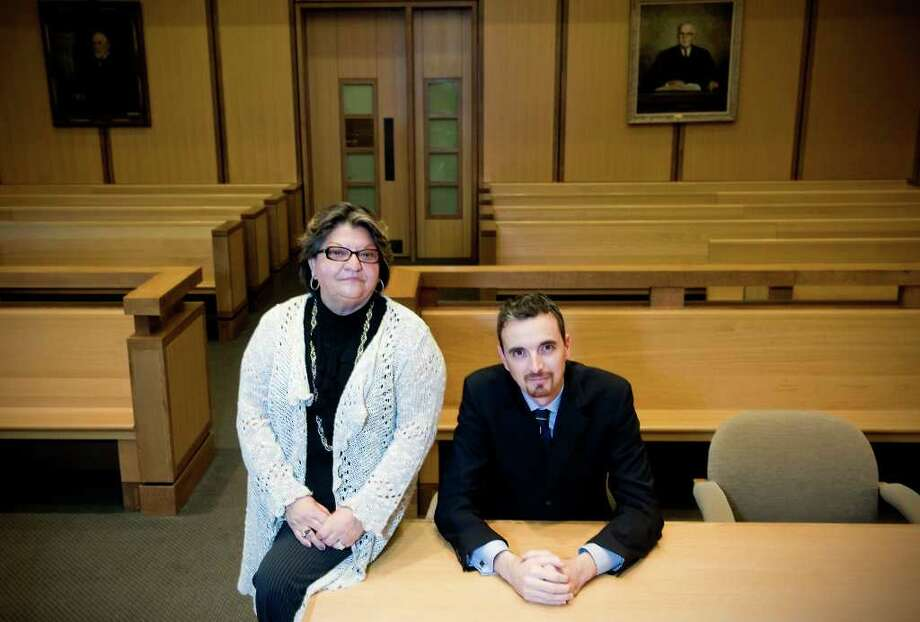 Julia Ayala-Gonzalez, 60, and Fernando Jover, 42, are full-time Spanish-language interpreters who translated in real-time the entire Andrew Kissel murder trial the past two weeks for the defendant, Carlos Trujillo, in Stamford Superior Court.  Ayala-Gonzalez works in the Norwalk courthouse and was brought over to Stamford for the trial. She is originally from Chile and Fernando is originally from Spain.  They sit in a courtroom at Stamford Superior Court in Stamford, Conn on Thursday December 16, 2010. Photo: Kathleen O'Rourke / Stamford Advocate