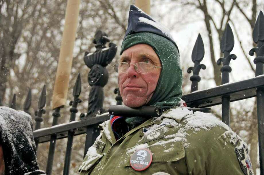 Elliott Adams of Sharon Springs, a former Veterans For Peace national president., chained himself to the White House fence on Thursday, Dec. 16, 2010, to protest war.  Dozens of members of Veterans For Peace and their supporters called for a meeting with President Obama and an end to American involvement in Afghanistan and other conflicts.  .(Courtesy of Ellen Davidson) Photo: Ellen Davidson