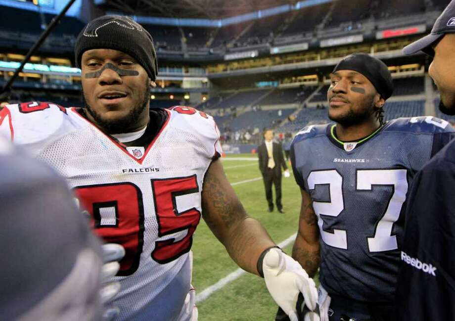 Atlanta Falcons' Jonathan Babineaux, left, and his younger brother, Seattle Seahawks' Jordan Babineaux (27), meet after an NFL football game, Sunday, Dec. 19, 2010, in Seattle. The Falcons won 34-18. (AP Photo/John Froschauer) Photo: John Froschauer, FRE / FR74207 AP