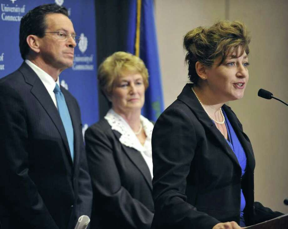 Susan Herbst, right, speaks at a news conference after being named the first female president, and 15th president of the University of Connecticut as Gov.-elect Dan Malloy, left, and Gov. M. Jodi Rell look on in Storrs, Conn., Monday, Dec. 20, 2010. (AP Photo/Jessica Hill) Photo: Jessica Hill, AP / AP2010