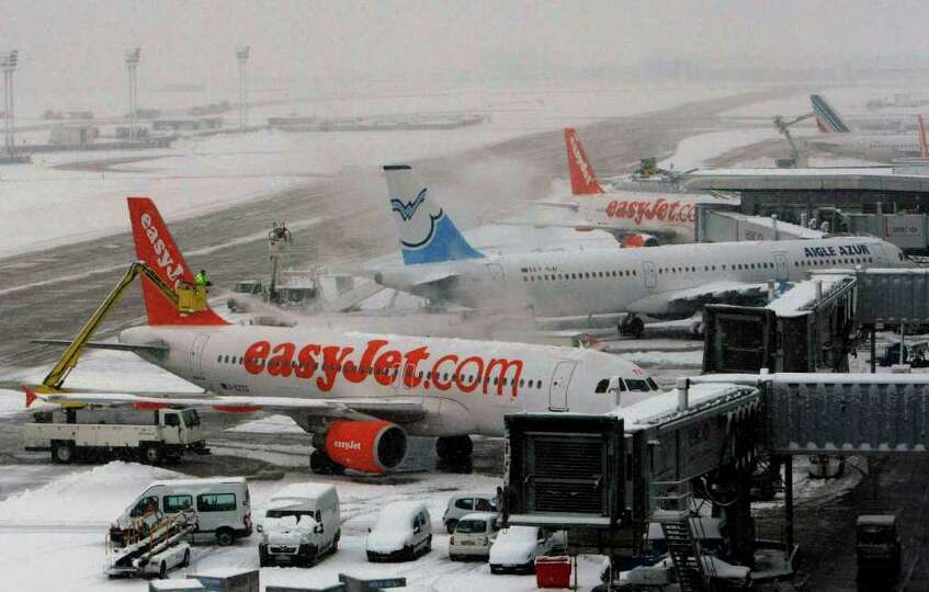 Planes is deiced at at Orly Airport south of Paris Monday, Dec. 20, 2010. Heavy snow on Monday shut