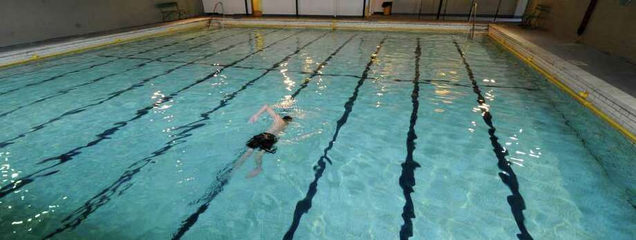 A swimmer uses the Albany City Bath No. 2 in Albany on Monday, December 20, 2010.  (Skip Dickstein / Times Union) Photo: Skip Dickstein