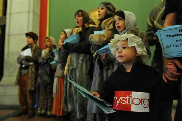 "Eleanor Baecker, 2, joins members of the New York State Theatre Institute to deliver messages of support for NYSTI to Gov.-elect Andrew Cuomo at the Attorney General?s office on Monday. Children from the cast of ""A Christmas Carol"" wear their costumes from the show, which closed Sunday. (Philip Kamrass / Times Union ) Photo: Philip Kamrass"