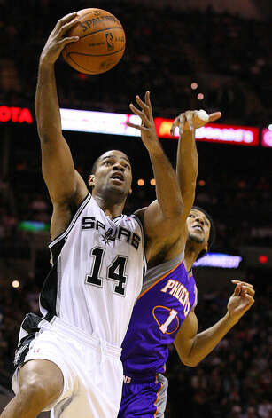 Spurs' Gary Neal drives to the basket ahead of Suns' Josh Childress during first half action Monday Dec. 20, 2010 at the AT&T Center. Photo: EDWARD A. ORNELAS/eaornelas@express-news.net