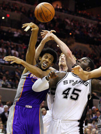 Spurs' Matt Bonner and teammate Spurs' DeJuan Blair grab for the ball against Suns' Josh Childress during first half action Monday Dec. 20, 2010 at the AT&T Center. Photo: EDWARD A. ORNELAS/eaornelas@express-news.net