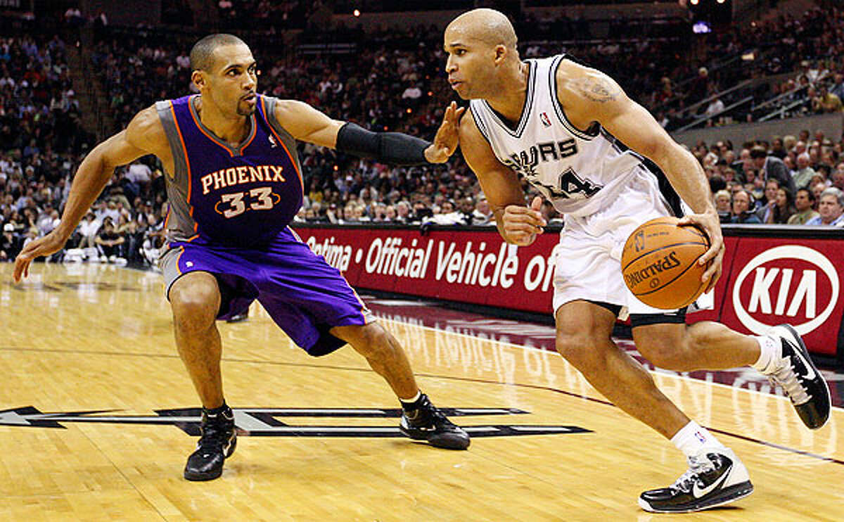 Spurs' Richard Jefferson look for room around Suns' Grant Hill during second half action Monday Dec. 20, 2010 at the AT&T Center. Spurs won 118-110.