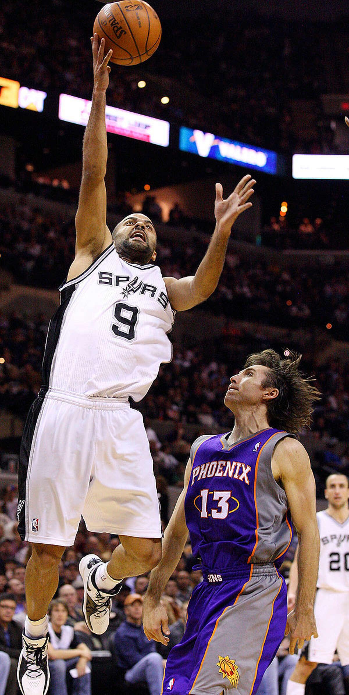 Spurs' Tony Parker shoots around Suns' Steve Nash during second half action Monday Dec. 20, 2010 at the AT&T Center. Spurs won 118-110.