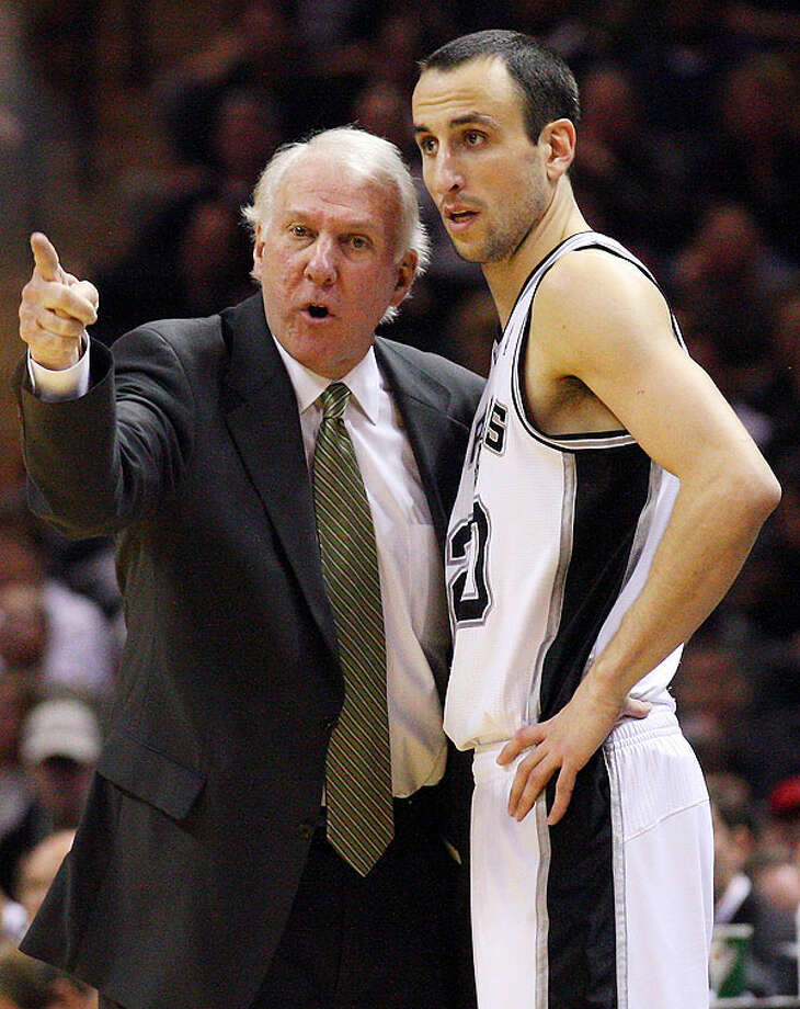 Spurs' head coach Gregg Popovich talks with Spurs' Manu Ginobili during second half action against the Suns Monday Dec. 20, 2010 at the AT&T Center. Spurs won 118-110. Photo: EDWARD A. ORNELAS/eaornelas@express-news.net