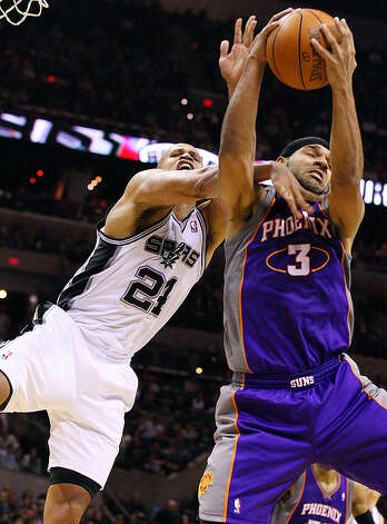 Spurs' Richard Jefferson and  Suns' Jared Dudley grab for a rebound during second half action Monday Dec. 20, 2010 at the AT&T Center. Spurs won 118-110. Photo: EDWARD A. ORNELAS/eaornelas@express-news.net