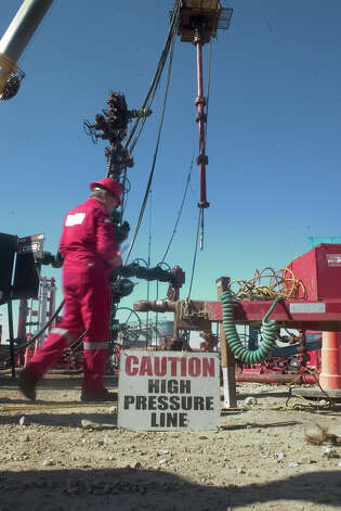Halliburton operates a shale well site near Poth. The company plans to cut the environmental damage of hydraulic fracturing jobs such as a this one by 2013. Photo: Timothy C. Baker/Special To The Houston Chronicle