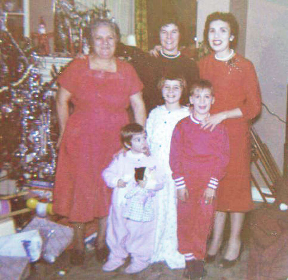 A Hines family Christmas, circa 1960: From left back row, Pat Hines' grandmother, mother and aunt; in front row, the author about 3 or 4 years old, her sister and brother. Photo: Contributed Photo / Fairfield Citizen contributed