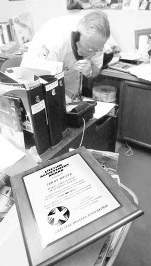 """""""The plaque Jerry White won with the Texas Tire Dealers Lifetime Achievement Award sits on his desk as he takes another call from a regular customer."""" Enterprise file photo from May 2006"""