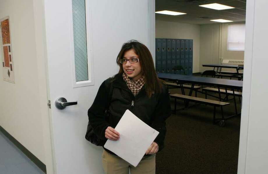 Senior Karla Bonilla,  of Bridgeport, enters a room in a newly acquired and renovated Kolbe High School building on Monday, December 20, 2010. Photo: B.K. Angeletti / Connecticut Post