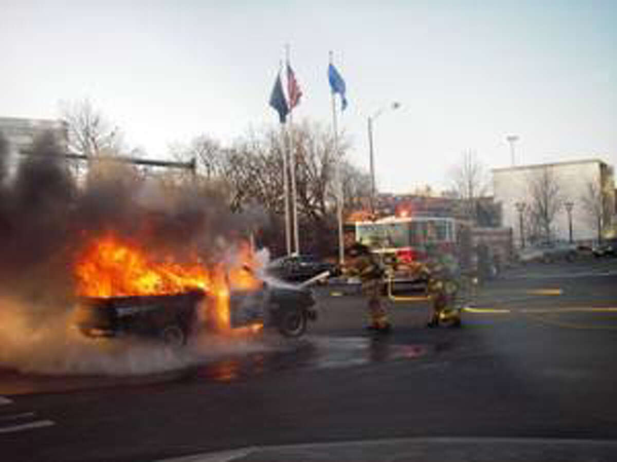 Stamford Fire and Rescue Department firefighters battle a truck fire at the intersection of Washington Blvd. and Broad St. in Stamford, Conn. on Monday, Dec. 20, 2010.