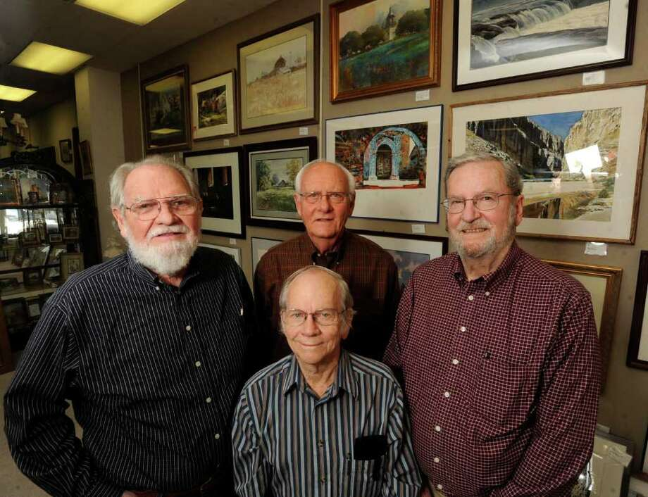 Finis Collins, left, Clay McGaughty, front, Lee Ricks, back, and Gordon West, right, the surviving members of the Watercolor Gang have been painting together for 47 years. They have a show on display at Antiques at Broadway.  Wednesday, Dec. 15, 2010. BILLY CALZADA / gcalzada@express-news.net  elda silva story Photo: BILLY CALZADA, STAFF / San Antonio Express-News