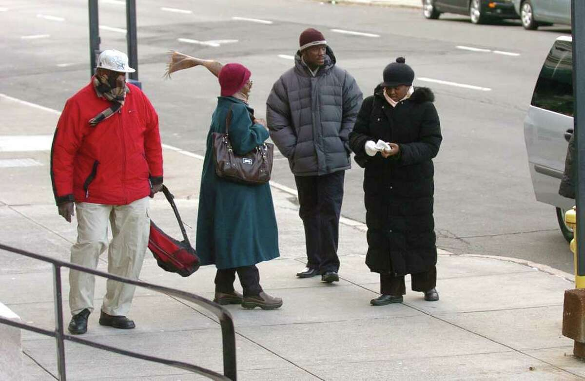 Members of the local Haitian community arrive at the Richard C. Lee United States Courthouse in downtown New Haven, Conn. to attend the sentencing hearing for Doug Perlitz on Tuesday December 21, 2010.