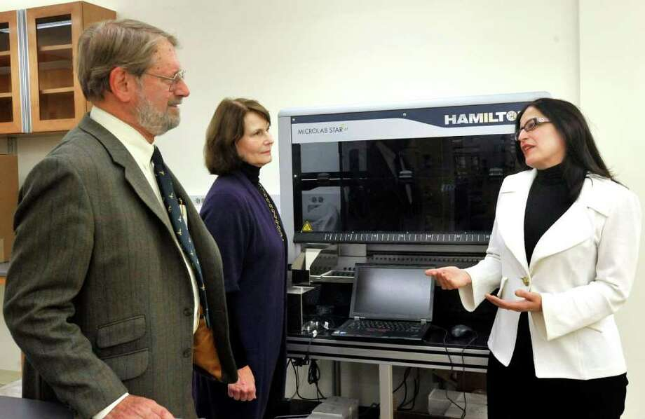Rudy and Sally Ruggles, left, talk with Dr. Shohreh Shahabi in front of the Functional Proteomics Platform that the Ruggles contributed the funds for the Danbury Hospital Biomedical Research Institute to acquire. Photographed Monday, Dec. 20, 2010. Photo: Michael Duffy / The News-Times