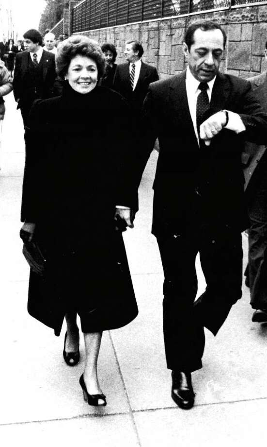 Newly sworn in Mov. Mario M. Cuomo and his wife, Matilda, walk down Madison Avenue near the Empire State Plaza on their way to the Executive Mansion.  Over the first lady's shoulder can be seen their son Andrew, 25, a special assistant to the new governor. ((Times Union Archive)