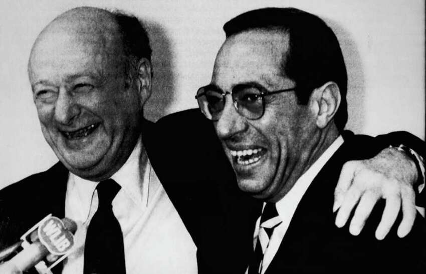 New York City Mayor Edward Koch and the new governor, Mario Cuomo, meet reporters on Jan. 14, 1983 at New York City Hall where they discussed the state's and city's finances. They squared off in a series of Democratic primary debates for governor in the summer of 1982. (Associated Press photo)