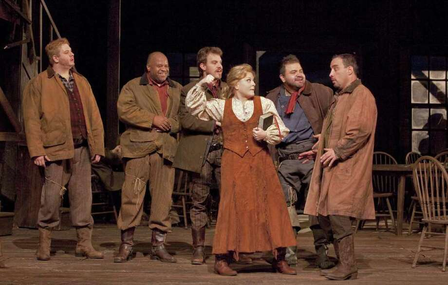 "Metropolitan Opera performers, from left, Adam Laurence Herskowitz as Harry, Michael Forest as Joe, David Crawford as Happy, Deborah Voigt as Minnie, Hugo Vera as Trin, and Richard Bernstein as Bello in Puccini's ""La Fanciulla del West"" (The Girl of the Golden West). The peoduction will be featured in ""The Met Live in HD"" presentation in January at Fairfield University. Photo: Contributed Photo / Fairfield Citizen contributed"