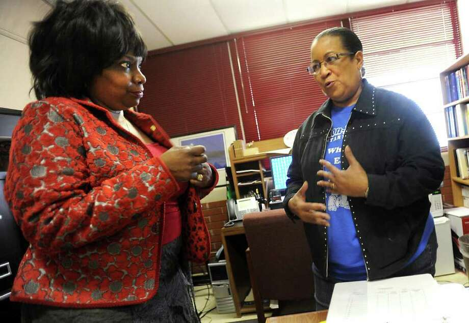 Dunbar Elementary Principle, Iris Williams talks with Curriculum Coordinator, Margie Clayton on her Williams' day at work before retirement at Dunbar Elementary in Beaumont, Friday. Tammy McKinley/The Enterprise Photo: TAMMY MCKINLEY / Beaumont