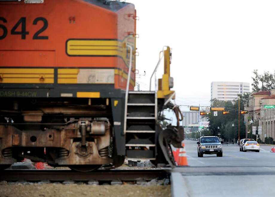 The railroad tracks near the intersection of Calder and M. L. King is reopened to vehicle and train traffic in Beaumont, Tuesday. Tammy McKinley/The Enterprise Photo: TAMMY MCKINLEY / Beaumont