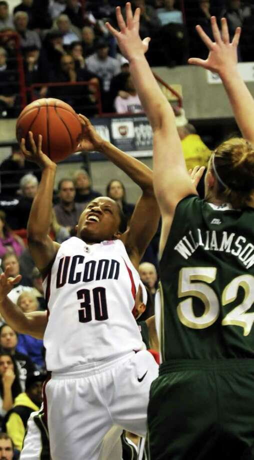 Connecticut's Lorin Dixon is guarded by Notre Dame's Erica Williamson in the second half of the Connecticut-Notre Dame NCAA women's basketball game at Storrs, Conn., Saturday, Jan. 16, 2010. UConn defeated third-ranked Notre Dame 70-46.  (AP Photo/Bob Child) Photo: AP