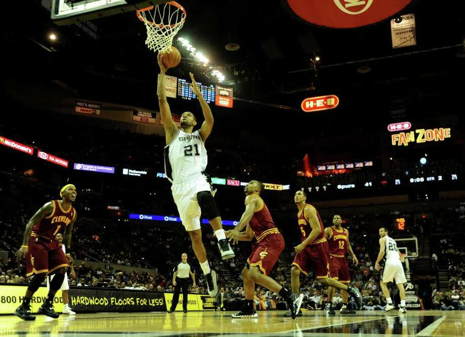 Tim Duncan of the San Antonio Spurs scores on a fast break against the Cleveland Cavaliers during first-half NBA action at the AT&T Center on Saturday, Nov. 20, 2010.