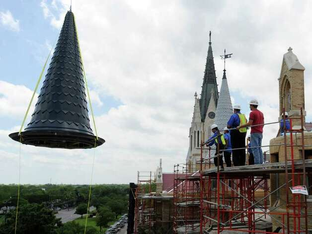 Construction crews prepare to place a spire atop the Main Building of Our Lady of the Lake University on April 21, 2010. A fire on May 6, 2008, destroyed the old one and much of interior of the building. Photo: BILLY CALZADA, SAN ANTONIO EXPRESS-NEWS / gcalzada@express-news.net
