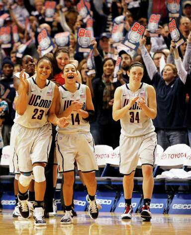 HARTFORD, CT - DECEMBER 21:  Maya Moore #23, Bria Hartley #14, and Kelly Faris of the Connecticut celebrate in the final minutes of a win over Florida State on December 21, 2010 in Hartford, Connecticut.  Connecticut set a record with 89 straight wins without a defeat. (Photo by Jim Rogash/Getty Images) *** Local Caption *** Maya Moore;Bria Hartley;Kelly Faris Photo: Jim Rogash, Getty Images / 2010 Getty Images