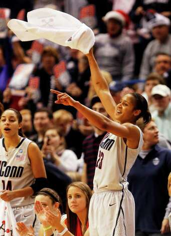 HARTFORD, CT - DECEMBER 21:  Maya Moore #23 of the Connecticut celebrates in the final minutes of a win over Florida State on December 21, 2010 in Hartford, Connecticut.  Connecticut set a record with 89 straight wins without a defeat. (Photo by Jim Rogash/Getty Images) *** Local Caption *** Maya Moore Photo: Jim Rogash, Getty Images / 2010 Getty Images