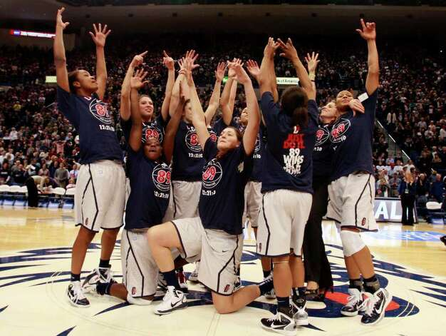 HARTFORD, CT - DECEMBER 21:  The Connecticut women's basketball team celebrates after a win over Florida State on December 21, 2010 in Hartford, Connecticut.  Connecticut set a record with 89 straight wins without a defeat. (Photo by Jim Rogash/Getty Images) Photo: Jim Rogash, Getty Images / 2010 Getty Images