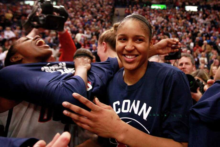 HARTFORD, CT - DECEMBER 21:  Maya Moore #23 of the Connecticut celebrates after a win over Florida State on December 21, 2010 in Hartford, Connecticut.  Connecticut set a record with 89 straight wins without a defeat. (Photo by Jim Rogash/Getty Images) *** Local Caption *** Maya Moore Photo: Jim Rogash, Getty Images / 2010 Getty Images
